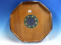 AN ART DECO MAHOGANY OCTAGONAL TRAY, THE TWO TONES OF BLUE PAINTED ON THE ROUND ARCHES OF THE