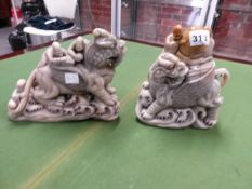 TWO CHINESE OATMEAL COLOURED SOAPSTONE GROUPS FEATURING SAGES ABOUT WINGED MYTHICAL BEASTS WALKING