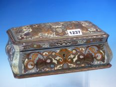 A VICTORIAN COROMANDEL GROUND BOULLE CASKET WITH DOMED RECTANGULAR LID AND BOMBE SIDES. W 23cms.