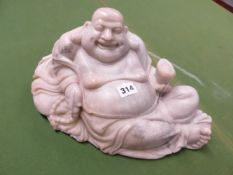 A CHINESE GREY GREEN SOAPSTONE CARVING OF BUDAI SMILING AS HE RECLINES ON HIS SACK OF POSSESSIONS, A