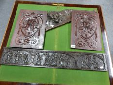 A PAIR OF ANTIQUE MAHOGANY PANELS CARVED WITH MASKS. 40 x 27.5cms. AN OAK MASK OVERMANTEL. W 89 x