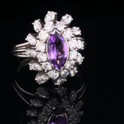A PLATINUM AMETHYST AND DIAMOND CLUSTER RING. THE CENTRAL MARQUIS CUT AMETHYST SURROUNDED BY A