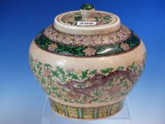 A CANTON CRACKLEWARE COMPRESSED BALUSTER JAR AND COVER PAINTED WITH BANDS OF LINGZHIH, LOTUS