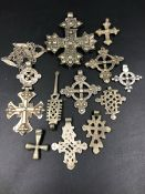 A GROUP OF TEN ETHIOPIAN COPTIC CROSS PENDANTS OF VARIOUS DESIGNS AND STYLES, ONE SUSPENDED ON A