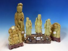 A CHINESE GREEN SOAPSTONE FIGURE OF GUANYIN. H 31cms., TWO FIGURES OF BUDAI AND SOAPSTONE GROUP OF