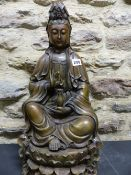A CHINESE BRONZE FIGURE OF GUANYIN SEATED ON LOTUS WASHED BY WAVES, SHE HOLDS A PEARL IN HER RIGHT