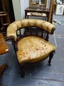 A VICTORIAN CARVED MAHOGANY TUB FORM DESK ARMCHAIR COVERED IN BUTTONED TAN LEATHER.