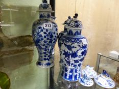THREE CHINESE BLUE AND WHITE BALUSTER VASES, A SLEEVE VASE AND SIX VARIOUS COVERS, THE TALLEST VASE.