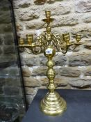 A BRASS SEVEN LIGHT CANDELABRUM, THE BRANCHES SCROLLING FROM A TURNED COLUMN ON CIRCULAR FOOT. H