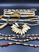 NINE STRANDS OF ETHNIC BEADED NECKLETS TO INCLUDE AMBER, BONE, IRON ETC.