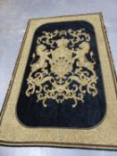 A MACHINE WOVEN ARMORIAL IN GOLD THREADS ON A BLACK GROUND, THE CROWNED SHIELD OF THREE FLEURS DE