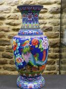 A CHINESE CLOISONNE ENAMEL BALUSTER VASE WORKED WITH TWO PHOENIX AMONGST PEONIES ON A DEEP BLUE