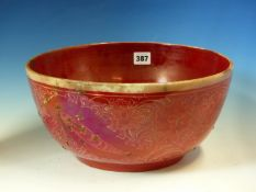 A RED LUSTRE POTTERY BOWL, THE EXTERIOR DECORATION OF SAZ LEAVES AND FLOWERS PARTIALLY SMOKED IN THE