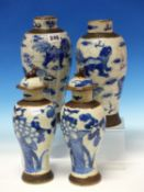 TWO PAIRS OF CHINESE BLUE AND WHITE CRACKLEWARE BALUSTER VASES, EACH WITH BRONZED BANDS, THE SMALLER