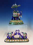 TWO INDIAN ENAMELLED WHITE METAL ELEPHANT GROUPS HUNG WITH SEED PEARLS, ONE CARRYING A DIGNITARY