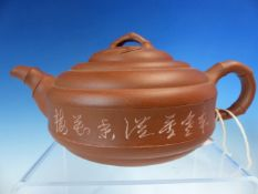 A YIXING RED WARE TEA POT, THE CAVETTO SIDES INCISED WITH CHARACTERS, FOUR CHARACTER SEAL MARK ON