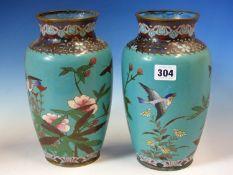 A PAIR OF JAPANESE CLOISONNE VASES WORKED WITH BIRDS AND FLOWERS ON A GREEN TURQUOISE GROUND. H