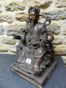 A CHINESE BRONZE FIGURE OF CAISHEN SEATED ON A DRAGON HANDLED THRONE HOLDING A RUYI SCEPTRE IN HIS