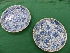 A PAIR OF 18th C. CHINESE BLUE AND WHITE DISHES, THE INTERIORS PAINTED OVERALL WITH SCROLLING LOTUS.