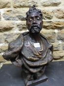 A PAINTED TERRACOTTA BUST OF A BEARDED NUBIAN HIS HAIR DRESSED INTO A TOP KNOT. H 44cms.