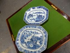 TWO 18th C. CHINESE BLUE AND WHITE CANTED RECTANGULAR PLATTERS CENTRALLY PAINTED WITH ISLAND SCENES.