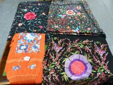 THREE CHINESE FLORAL EMBROIDERED BLACK SILK SHAWLS TOGETHER WITH A TERRACOTTA RED SHAWL