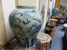 A PAIR OF MING STYLE BLUE AND WHITE BALUSTER JARS, EACH PAINTED WITH TWO QILIN BY PLANTAINS. H