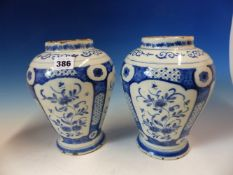 A PAIR OF 18th C. DUTCH DELFT BLUE AND WHITE OVOID JARS, EACH PAINTED WITH FOUR PANELS OF FLOWERS