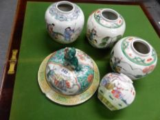 FOUR CHINESE POLYCHROME JARS TOGETHER WITH A VASE LID. Dia. 25cms.