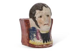 Unusual early 19th century Staffordshire plinth, the front modelled possibly as Napoleon, 10cm high