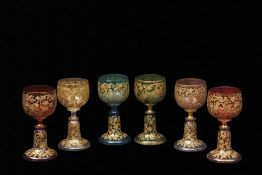 Group of six facon de venise wine glasses of various colours, all with a trailing floral gilt design