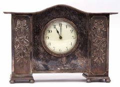 Decorative late 19th/early 20th century silver plated cased mantel clock with plain serpentine
