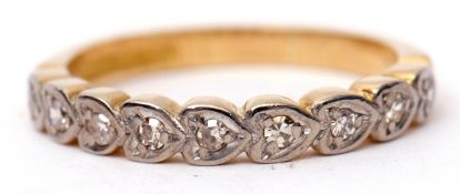 18ct gold diamond half eternity ring featuring nine small diamonds, each in heart shaped engraved