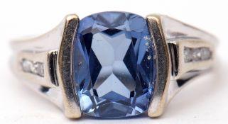 Precious metal sapphire and diamond ring, the centre barrel shaped sapphire raised between diamond