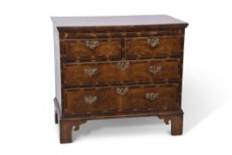 Late 18th century and later figured walnut and cross banded chest of two short over two long full