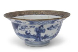 Chinese 18th century blue and white bowl with metal rim, painted with Chinese figures in garden