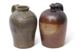 Two large stoneware flagons, late 19th century, with strap handles, one manufactured by Canal