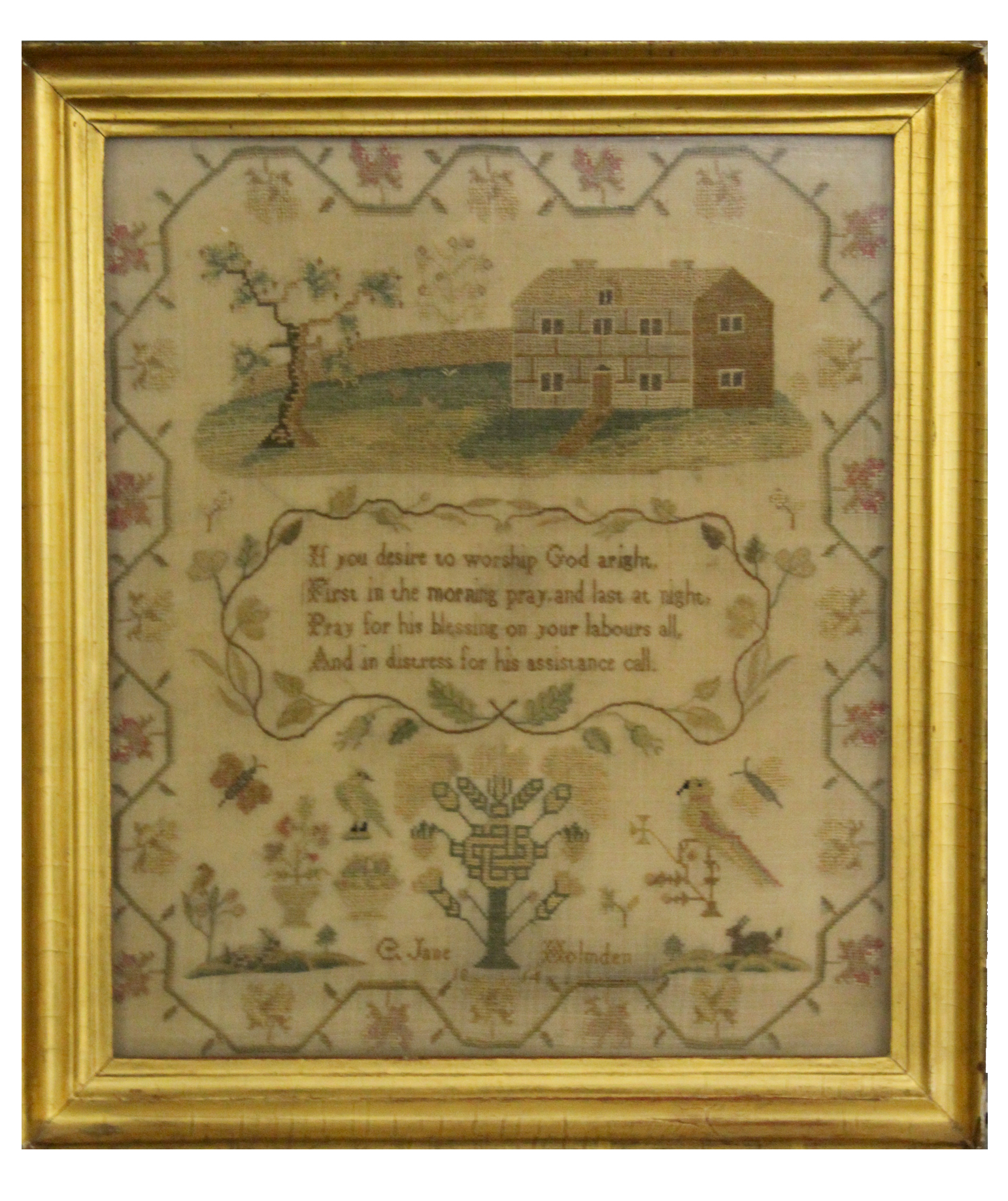 Lot 747 - E Jane Holmden (1814) silk work sampler featuring a country house to top above a religious verse