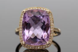 Amethyst and diamond ring, a cushion cut purple amethyst approx 9.40ct, set within a diamond