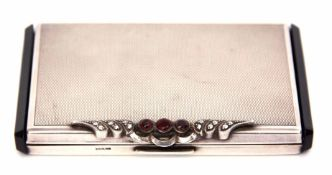Early 20th century black composite mounted and white metal powder compact of rectangular form with