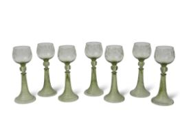 Group of seven Bohemian wine glasses, the bowls engraved with a fruiting vine design above a stem