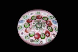19th century Clichy paperweight, the salmon pink over white ground set with three rows of