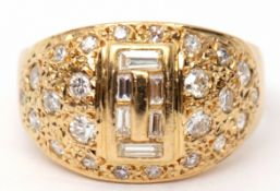 Mixed cut diamond cluster ring, the centre decorated with six graduated baguette cut diamonds, the