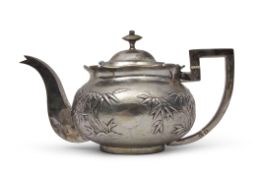 Late 19th century/early 20th century Chinese white metal tea pot embossed with bamboo designs to a