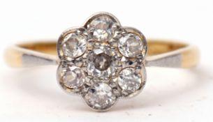 Diamond cluster ring featuring seven brilliant cut diamonds, the principal diamond 0.15ct approx,