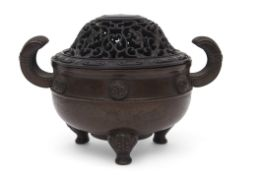 Chinese bronze, possibly Ming dynasty, the body with applied florettes and the censer on three