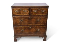 Late 18th century and later walnut crossbanded chest with two short over two long drawers, with