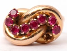 Stylised ruby set dress ring, an entwined plain polished tubular design set with eight small