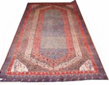 Modern Caucasian rug, multi-gull border and central geometric panels, mainly blue, red and beige