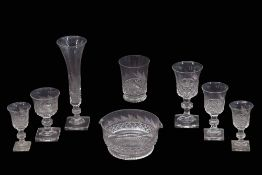 Extensive suite of mid 19th century cut glass wares including champagne flutes, wine glasses,